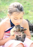 Rabbit in kids hands Royalty Free Stock Photos