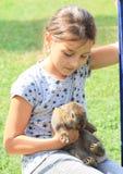 Rabbit in kids hands Stock Photo