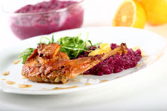Rabbit leg with red cabbage Royalty Free Stock Image