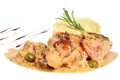 Rabbit legs with potato puree and rosemary Royalty Free Stock Photo