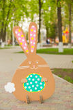 Rabbit made from organic paper in park. Decoration stock photo