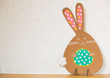 Rabbit made ��from organic paper on a white wall. Decoration Royalty Free Stock Images