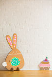 Rabbit made ��from organic paper on a white wall. Decoration Royalty Free Stock Photography