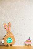 Rabbit made ��from organic paper on a white wall. Decoration Stock Photography