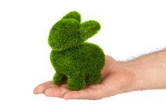 Rabbit made of grass in hand Stock Image