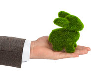Rabbit made of grass in hand Royalty Free Stock Image