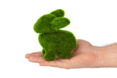 Rabbit made of grass in hand. Isolated on white background Stock Photography