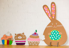 Rabbit made from organic paper on a white wall. Decoration Stock Images