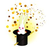 A rabbit in a magician`s hat, a magic wand Stock Image
