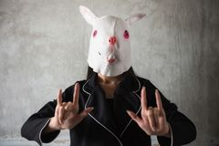 Rabbit mask girl show love hand sign. Girl with Bunny rabbit mask showing love hand sign with old dirty wall background and copy space for text. Easter and stock image