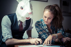 Rabbit mask man and woman working Royalty Free Stock Images