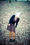 Rabbit mask unreal woman. At the park Royalty Free Stock Photo