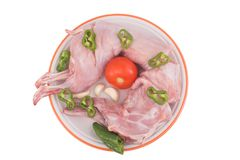Rabbit meat. Tomato, garlic and pepper royalty free stock photos