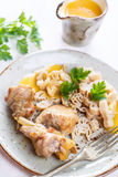 Rabbit meat with pasta and vegetable sauce. Rabbit meat with pasta, parsley and vegetable sauce royalty free stock photos