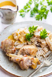 Rabbit meat with pasta and vegetable sauce. Rabbit meat with pasta, parsley and vegetable sauce royalty free stock photography