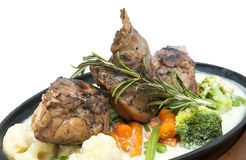 Rabbit meat and potatoes. Roasted rabbit meat and potatoes with vegetables Stock Photography