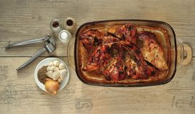 Rabbit meat roaster with onion cumin and garlic on wooden vintage table Stock Photography