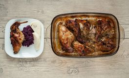 Rabbit meat roaster with onion cumin and garlic on wooden vintage table with cabbage and dumpling Stock Images