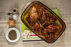 Rabbit meat roaster with onion cumin and garlic on wooden vintage table Stock Images
