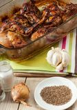 Rabbit meat roaster with onion cumin and garlic on wooden vintage table Royalty Free Stock Photography