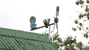 A Rabbit and Moon Wood Wind Vane on the Roof. Of a House stock video
