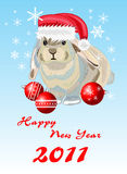 Rabbit. New Year. Rabbit with red cap. New Year card Royalty Free Stock Images