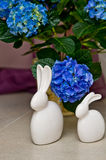 Rabbit ornaments and hydrangea flowers Stock Image