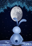 Rabbit with oval moon in the night Royalty Free Stock Photo