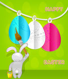 Rabbit paints Easter eggs. Royalty Free Stock Photography