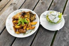 Rabbit,potato wedge and cucumber salad Royalty Free Stock Photo