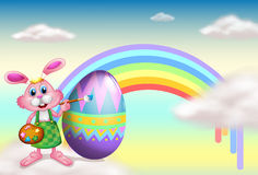 A rabbit and a rainbow. Illustration of a rabbit and a rainbow in the sky Stock Photography