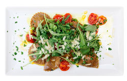 Rabbit ravioli with rocket salad isolated on white Royalty Free Stock Photo