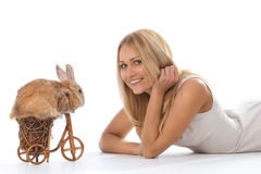Rabbit riding bike to young woman Royalty Free Stock Images