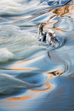 Rabbit River Rapids. Winter landscape captured with blurred motion of a rapids on the Rabbit River, Michigan, USA royalty free stock photo