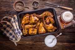 Rabbit. Roasted rabbit slices with american potatoes garlic spices salt,pepper cumin and draft beer. Hunting cuisine Royalty Free Stock Photography