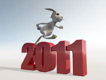 Rabbit run on 2011 numbers. White rabbit run on 2011 numbers Royalty Free Stock Image