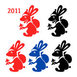 Rabbit Santa. Rabbit dressed like Santa Claus color silhouettes Royalty Free Stock Photography