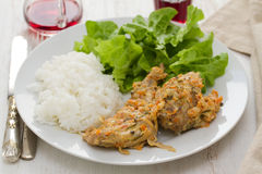 Rabbit with sauce,  boiled rice and lettuce Stock Photos