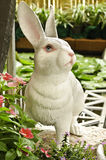 Rabbit sculpture in garden Stock Photo