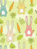 Rabbit seamless background. Seamless background with rabbits, carrots and leaves Stock Photo