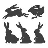 Rabbit set. Stylized silhouettes of sitting and running rabbits, on white background. Vector illustration stock illustration