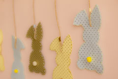 Rabbit shaped cloth patches hanging on the wall.  Royalty Free Stock Images