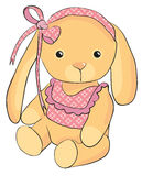 Rabbit sits with a bow Stock Photo