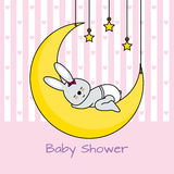 Rabbit sleeping on the moon. Baby girl shower card Royalty Free Stock Photography