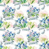 Rabbit in spring. Watercolor seamless pattern. Rabbit in spring. Watercolor spring seamless pattern with bunny and first spring flowers. Hand painted Stock Photo