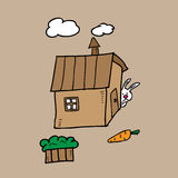 Rabbit stares on carrot. Rabbit hides behind house looking for carrot Royalty Free Stock Images
