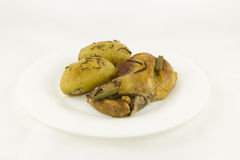 Rabbit stew and baked potatoes with rosemary Royalty Free Stock Image