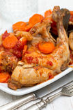 Rabbit stew with carrot and tomato on white dish Stock Images