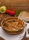Rabbit stew. Setup on a wooden table, served in romanian traditional earthenware royalty free stock images
