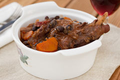 Rabbit stew in the white bowl with glass. Of wine Stock Photos